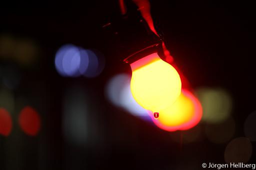 Coloured lightbulbs in rain
